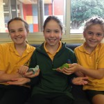 Three very happy students holding our very tame pet friends.